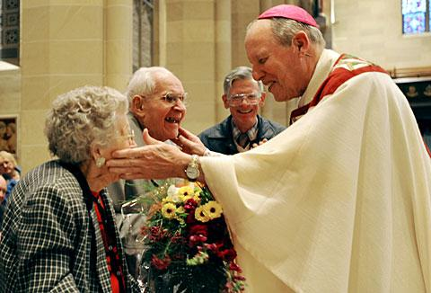 Bishop Clark with Walter & Cecilia Meisenzahl, married 72 years.