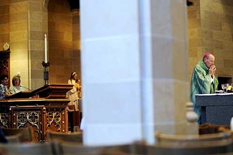 Bishop Matthew H. Clark prays during the Mass.