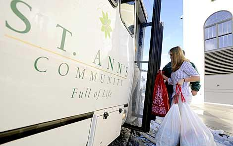Students load gifts onto St. Ann's bus.