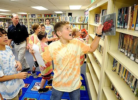 Nicholas Schaertl finds a clue at the school library.