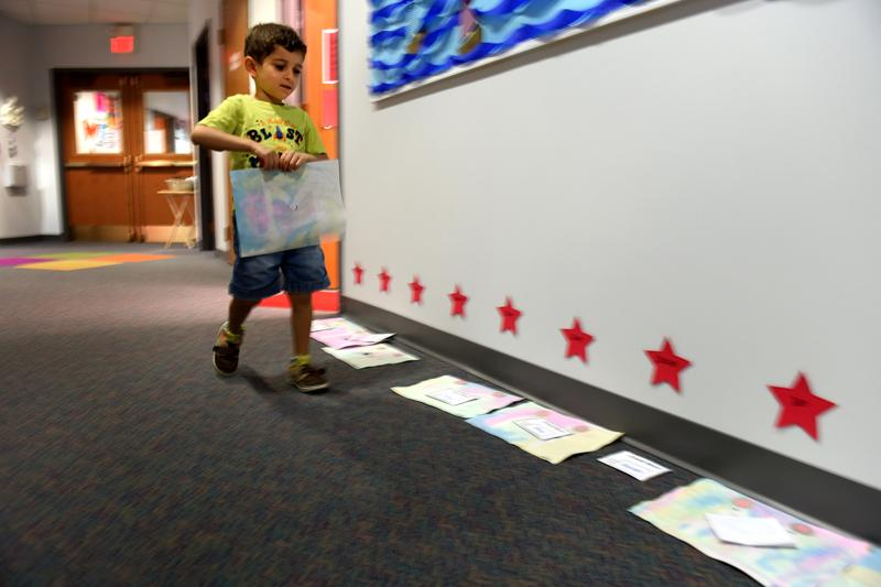Josiah places his painting in the hallway to dry at St. Patrick's Preschool is located in the preschool wing of St. Patrick Church's parish hall in Victor Sept. 23.