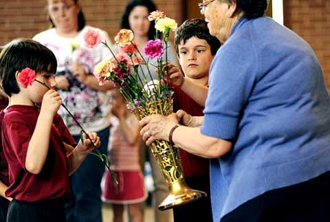 Ryan Martin (left) and Keaton Crawford bring up their flowers.