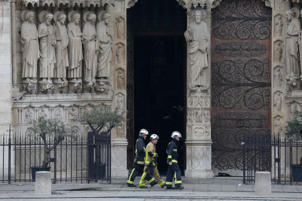 Firefighters inspect Notre Dame Cathedral April 16. (CNS photo by Paul Haring)