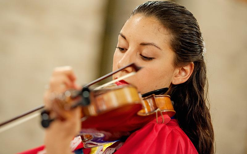 Marina Ramos plays the violin during the Dec. 12 Mass.