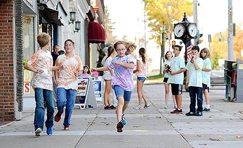 Students race down South Main Street.