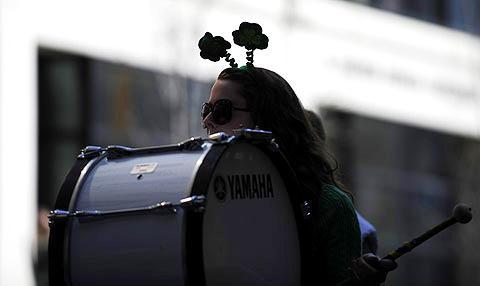 A drum corp member sports festive headwear.