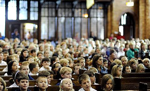 Students pack Geneva's St. Stephen Church.
