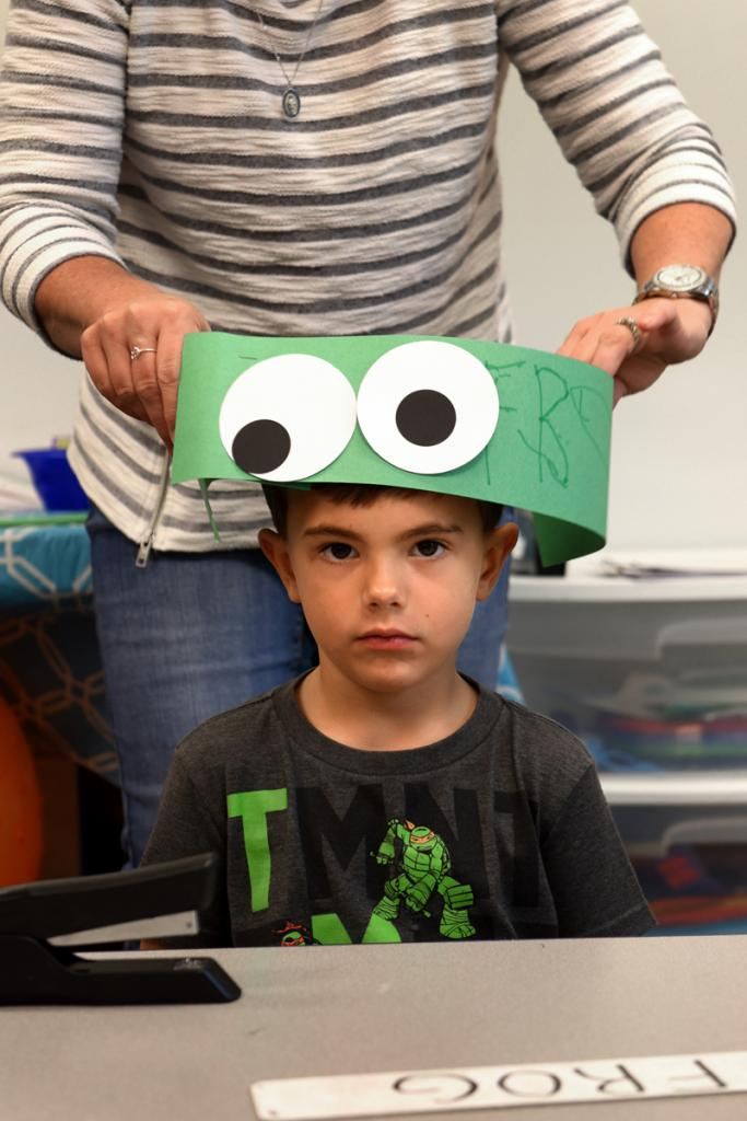 Jack, 4, gets some assistance from teacher Jackie Lanzillo while fitting his frog hat at St. Patrick's Preschool is located in the preschool wing of St. Patrick Church's parish hall in Victor Sept. 23. The preschool offers classes for 3, 4 and 5 year olds.