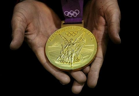 Musnicki holds the gold medal she won in the women's eight.