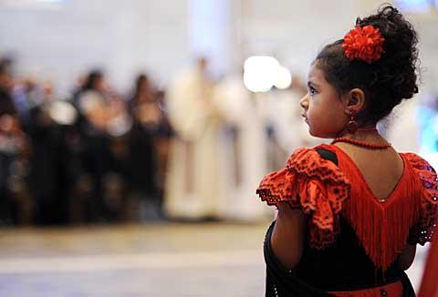 Four-year-old Estefania Martinez Muñoz stands during the Mass.
