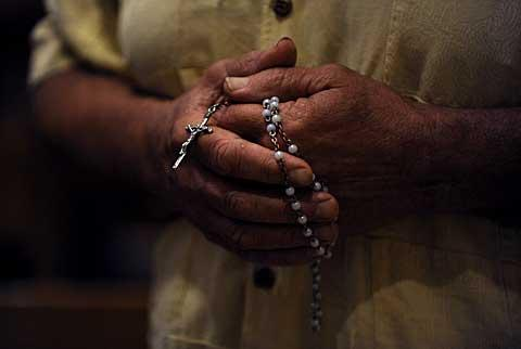 Some in attendance held rosaries as they prayed.