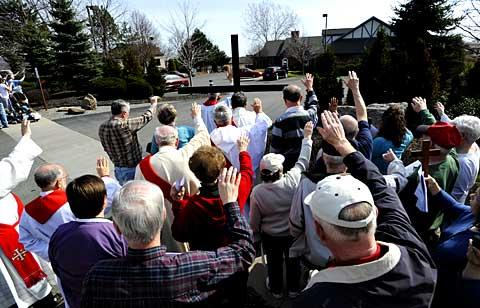 Participants join in prayer outside the abortion clinic.