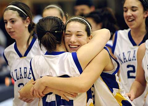 Sara Hart-Predmore (back to camera) hugs Haley Swanson.