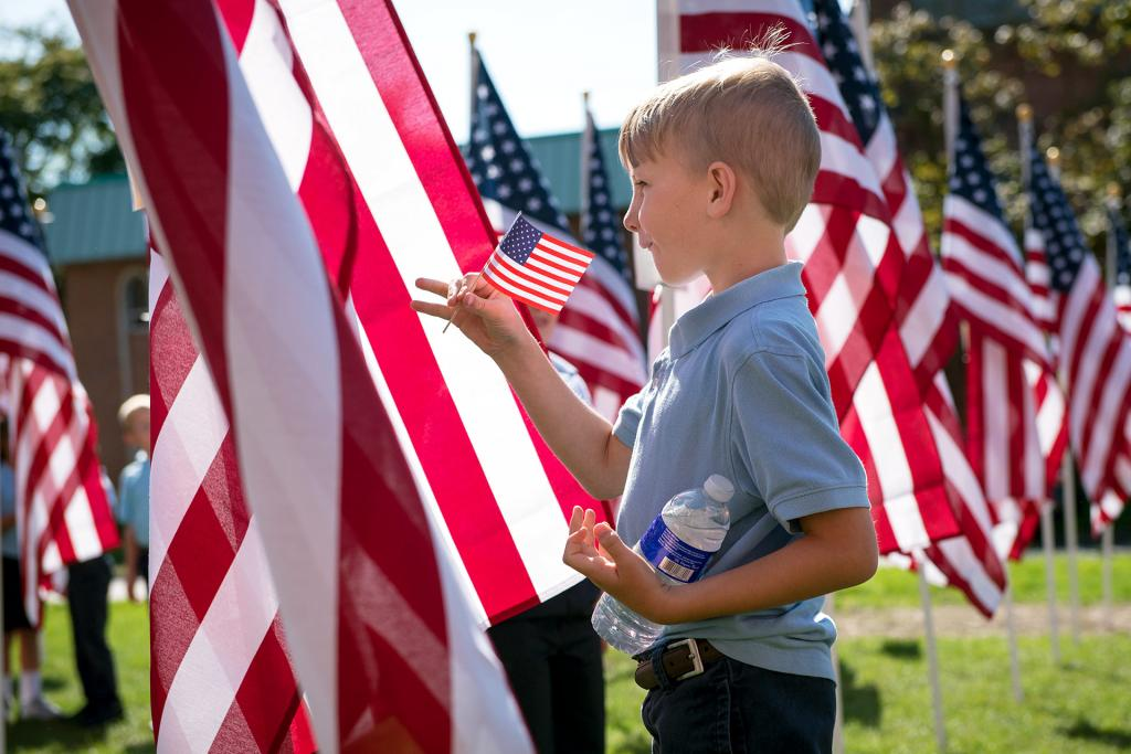 St. Mary School third-grader Henry May looks over the flags.