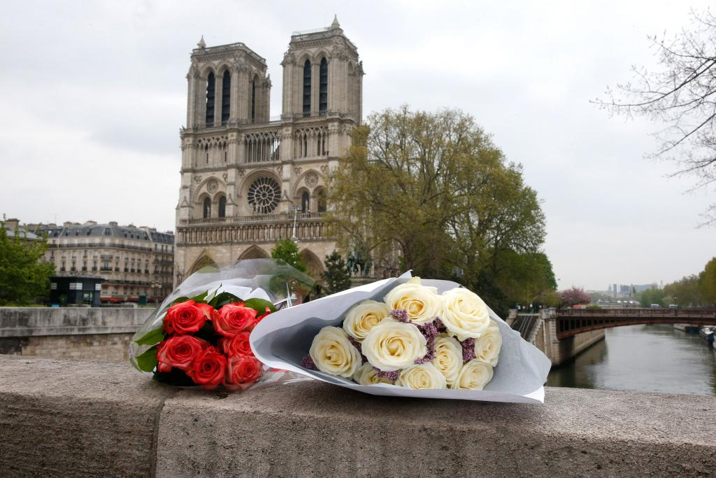 Flowers are seen on the ledge of a bridge near Notre Dame Cathedral April 16.(CNS photo by Paul Haring)