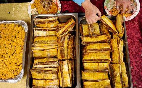 People partake in Puerto Rican style pasteles.