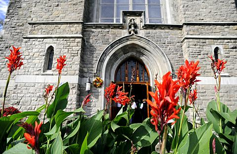 Flowers bloom in front of St. Stephen Church.