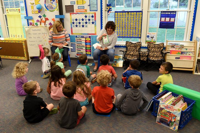 Teachers Jackie Lanzillo and Kathy Carrozzi, left, work with students at St. Patrick's Preschool is located in the preschool wing of St. Patrick Church's parish hall in Victor Sept. 23.