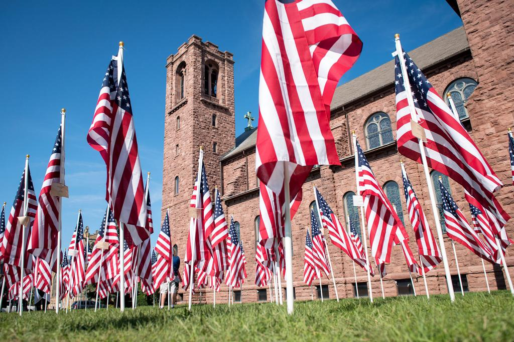 Flags stand in a Field of Honor outside of Canandaigua's St. Mary Church.