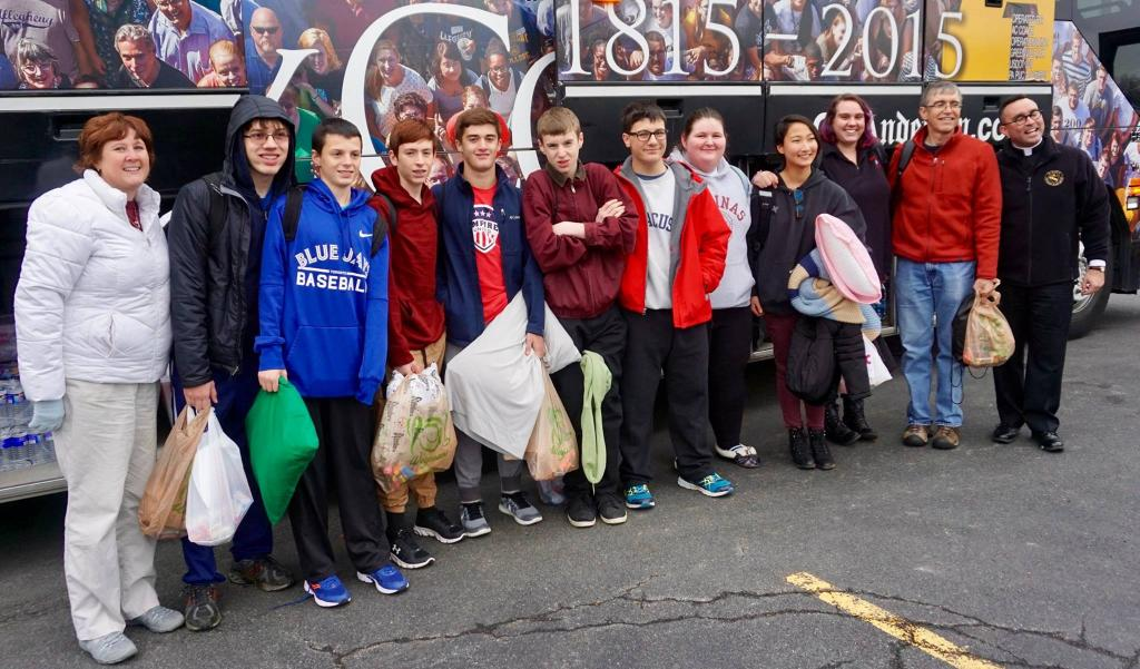 Teens and chaperones from Blessed Sacrament, St. Boniface and St. Mary Churches in Rochester board the bus to Indianapolis Nov. 15. (Photo courtesy Blessed Sacrament, St. Boniface and St. Mary Churches)