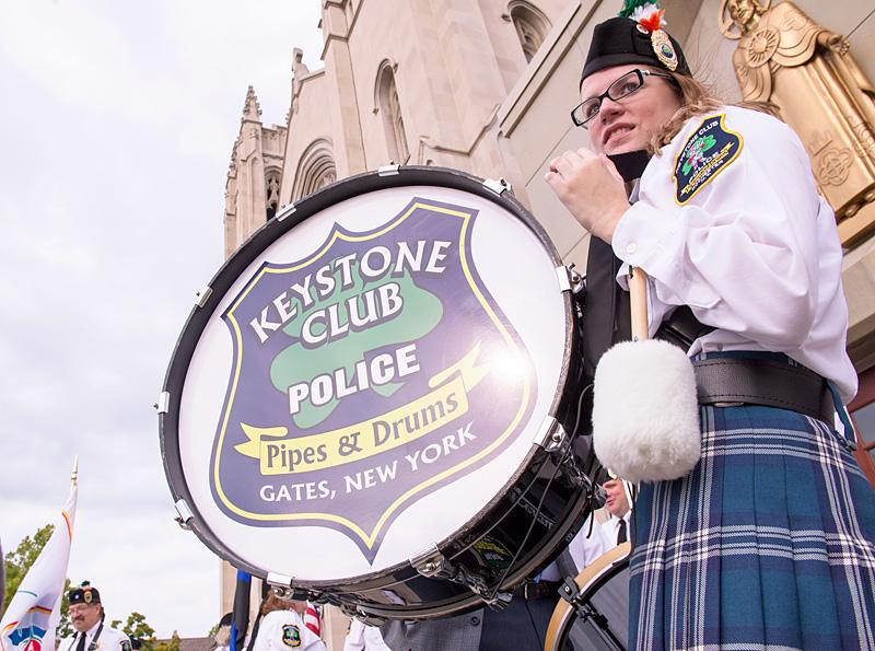 Keystone Club Pipes and Drums member Molly Giblin stands outside Sacred Heart Cathedral before Mass.