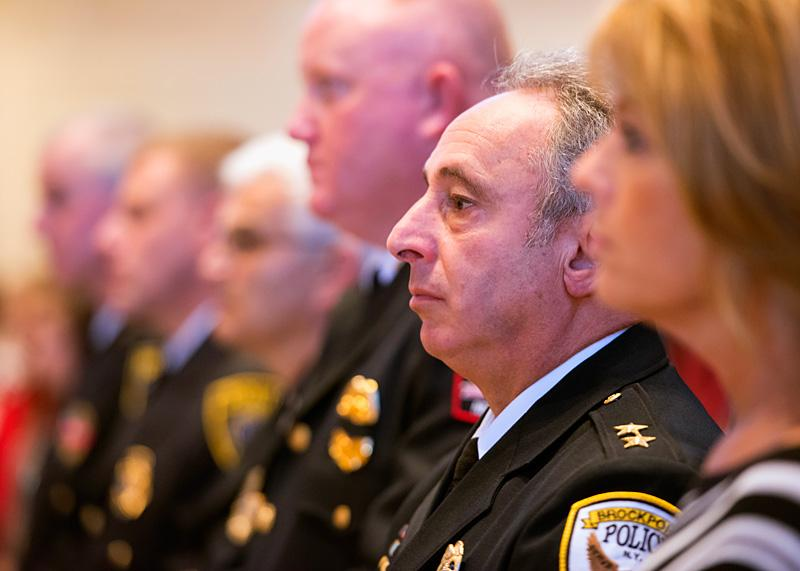 Brockport Chief of Police Daniel Varrenti sits in the front row during Mass.