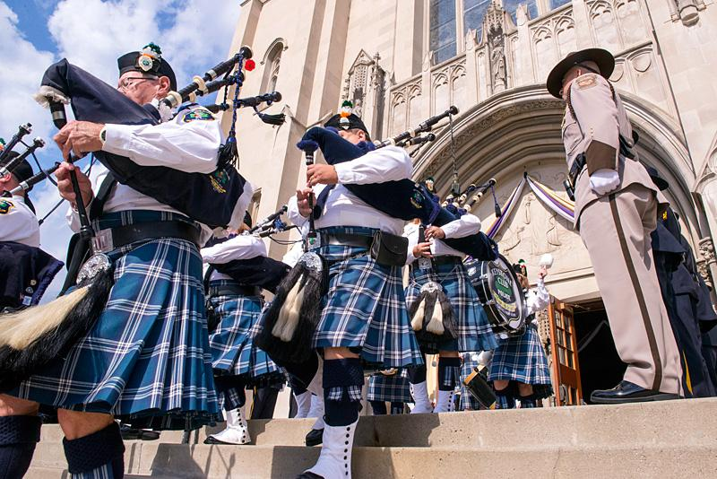 Keystone Club Pipes and Drums members recess out of the cathedral at the end of Mass.