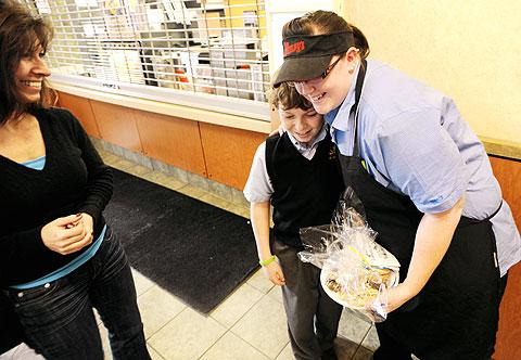 Carter Coston gets a hug from Wendy's employee Caitlyn Scott.