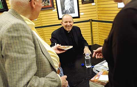 Bishop Clark talks to fans at Barnes & Noble.