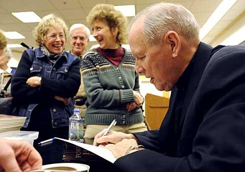 Bishop Clark signs books for fans at Barnes & Noble.