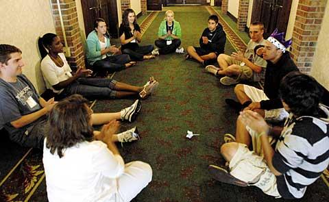 A group plays a game during Parish Sharing.