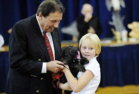 Dr. Gerald Benjamin and Anna Crawford with Anna's dog, Maddie.