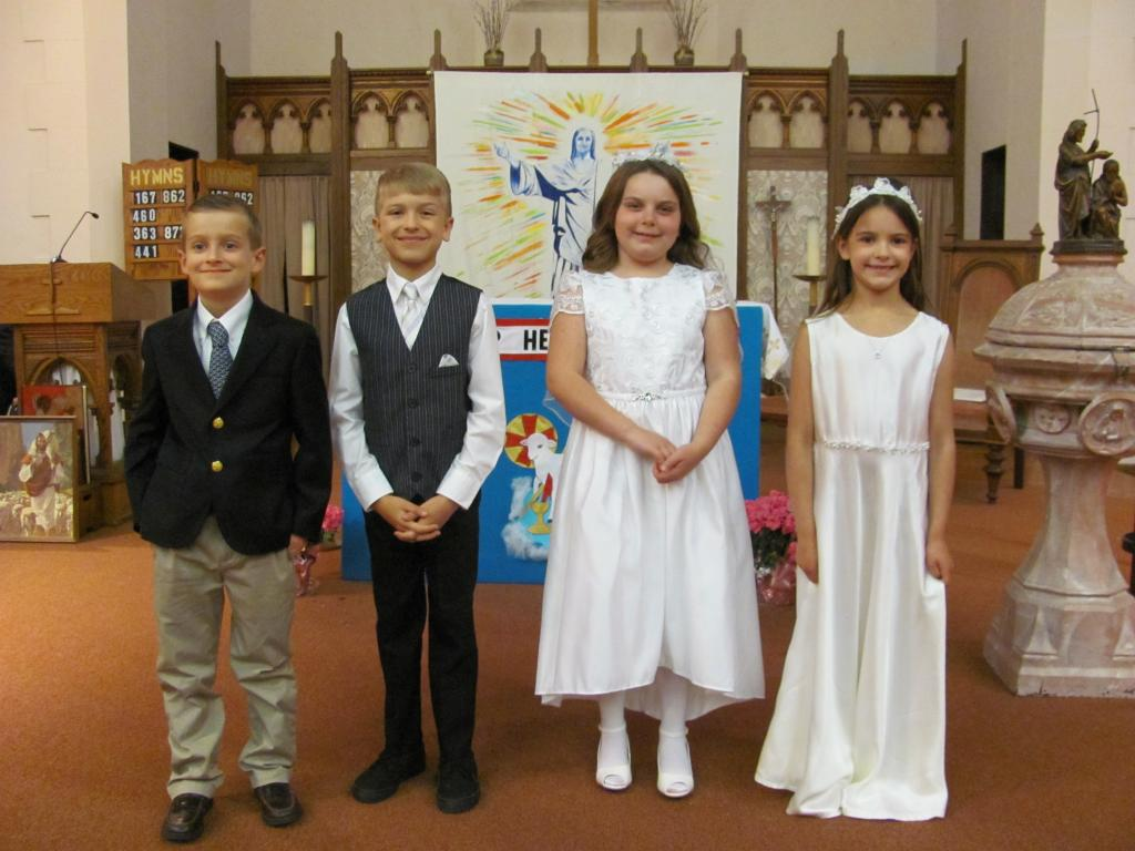 Ryan, Finn, Joliette and Rosabel, 8, received their First Holy Communion at St. Michael Church, Penn Yan. (Submitted by Finn's mom, Carrie)