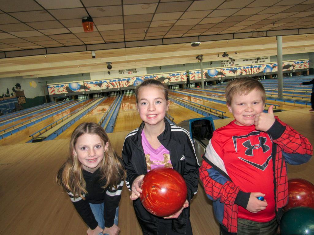 5th graders Ellen Burke and Caroline Hayes and 3rd Grader Joseph Hayes enjoy Family Fun Day bowling at Miller Lanes.