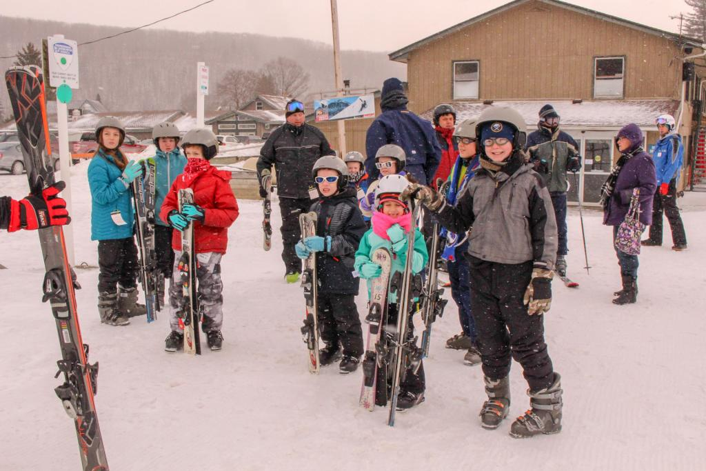 Students, siblings and parents get ready to learn to ski on Family Fun Day at Swain Resort.