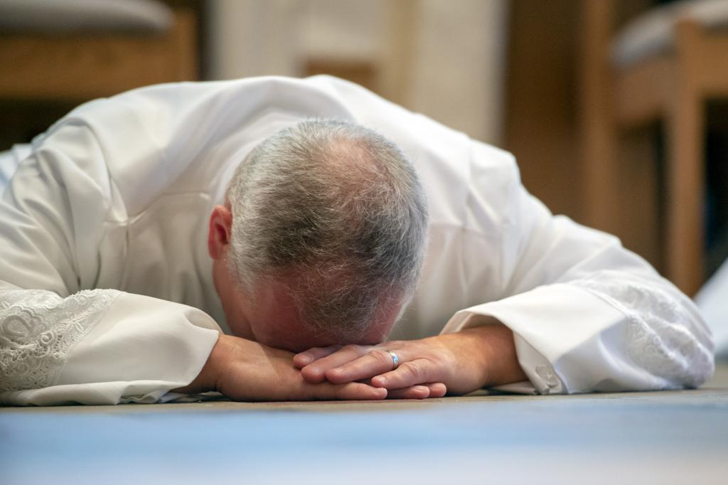 Deacon Michael Kristan prostrates before the altar.
