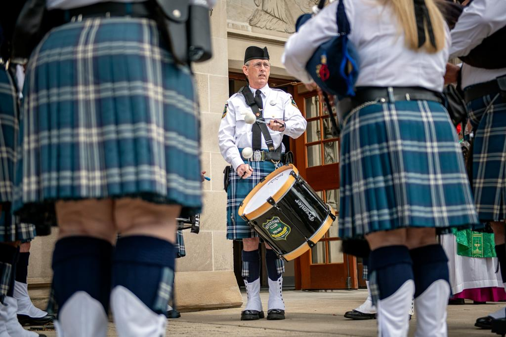 Keystone Club Pipes and Drums member Mike Roche plays outside of the cathedral following Mass.