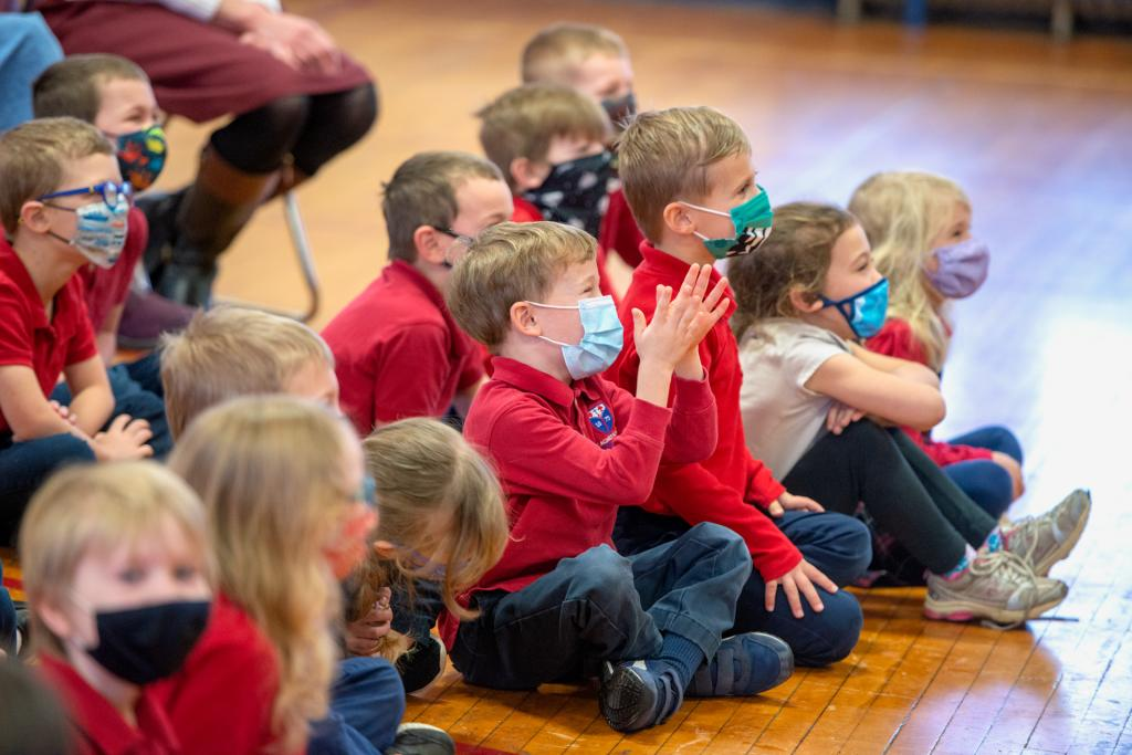 St. Agnes students clap while watching the magic show.