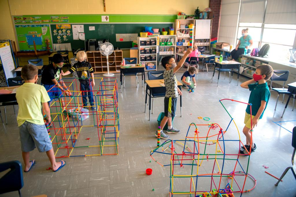 Students construct a tower in one of the classrooms.