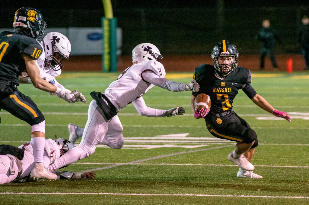 Andrew Passero runs the ball for McQuaid.