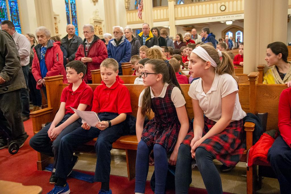 St. Agnes School students look on during the imposition of ashes at St. Agnes Church in Avon.