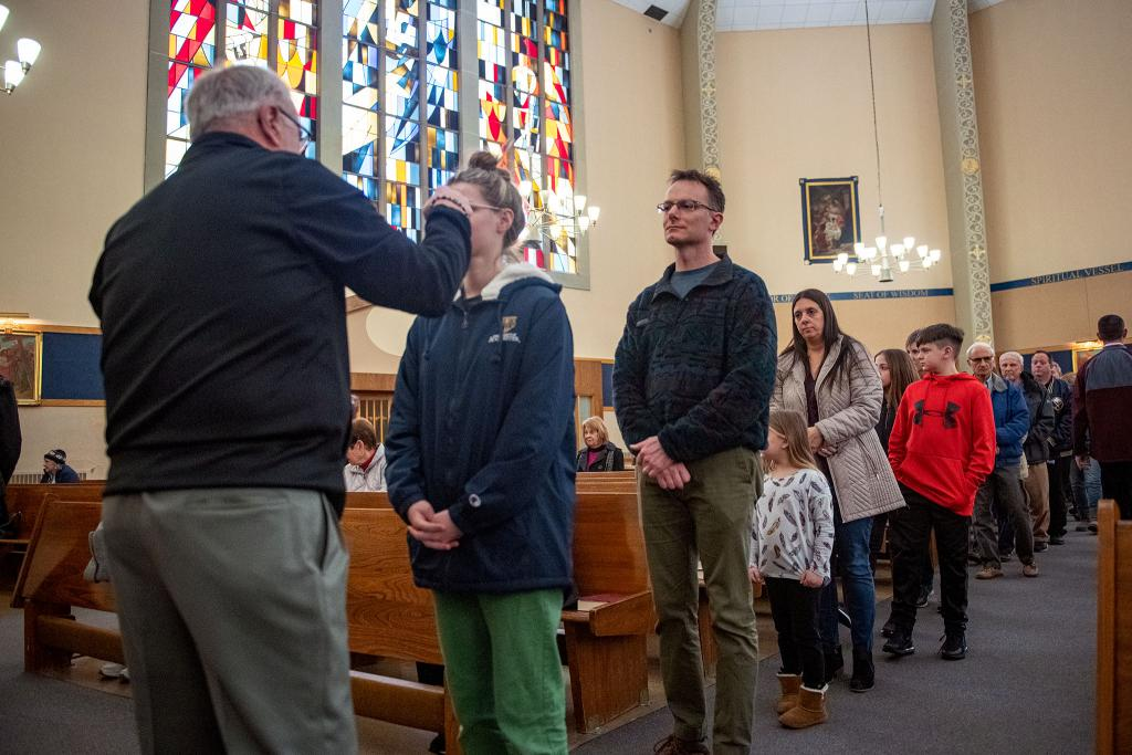 Parishioners of Our Mother of Sorrows Church in Greece line up to receive ashes Feb. 26.