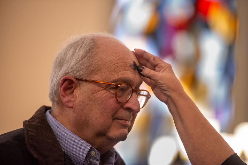 A parishioner of Greece's Our Mother of Sorrows Church receives ash.