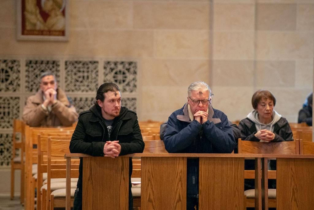 Congregants at Sacred Heart Cathedral in Rochester kneel after receiving ashes on Feb. 26.