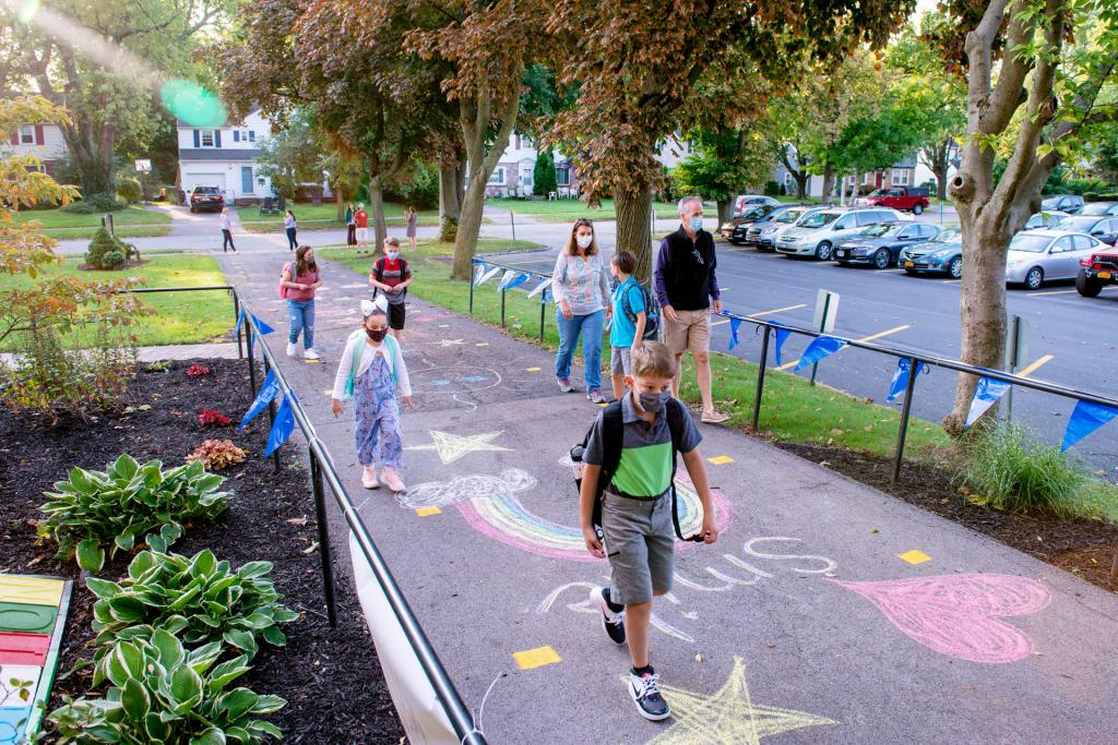 Students head into the school for the first day of classes at Seton Catholic School in Brighton Sept. 9.