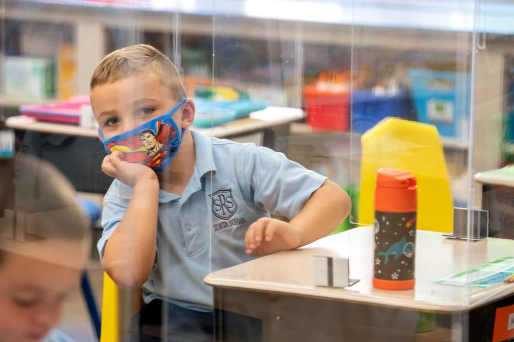 Noah DeStefano listens to his teacher while in class at St. Rita School in Webster Sept 9.