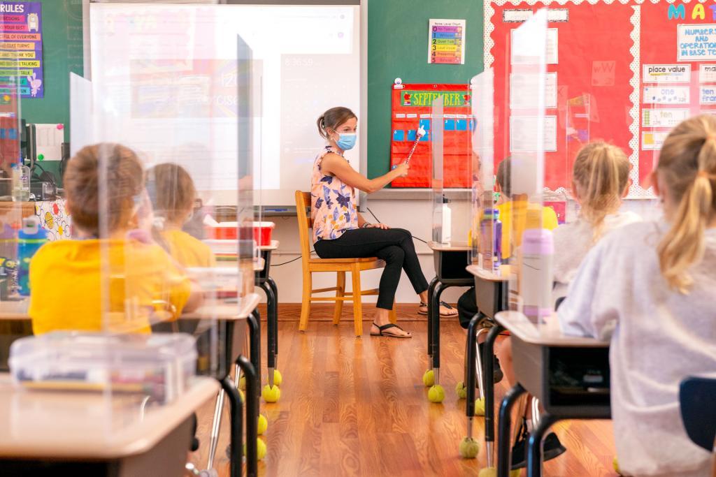 First-grade teacherCarmen Henry leads her class in a lesson at St. Rita School.