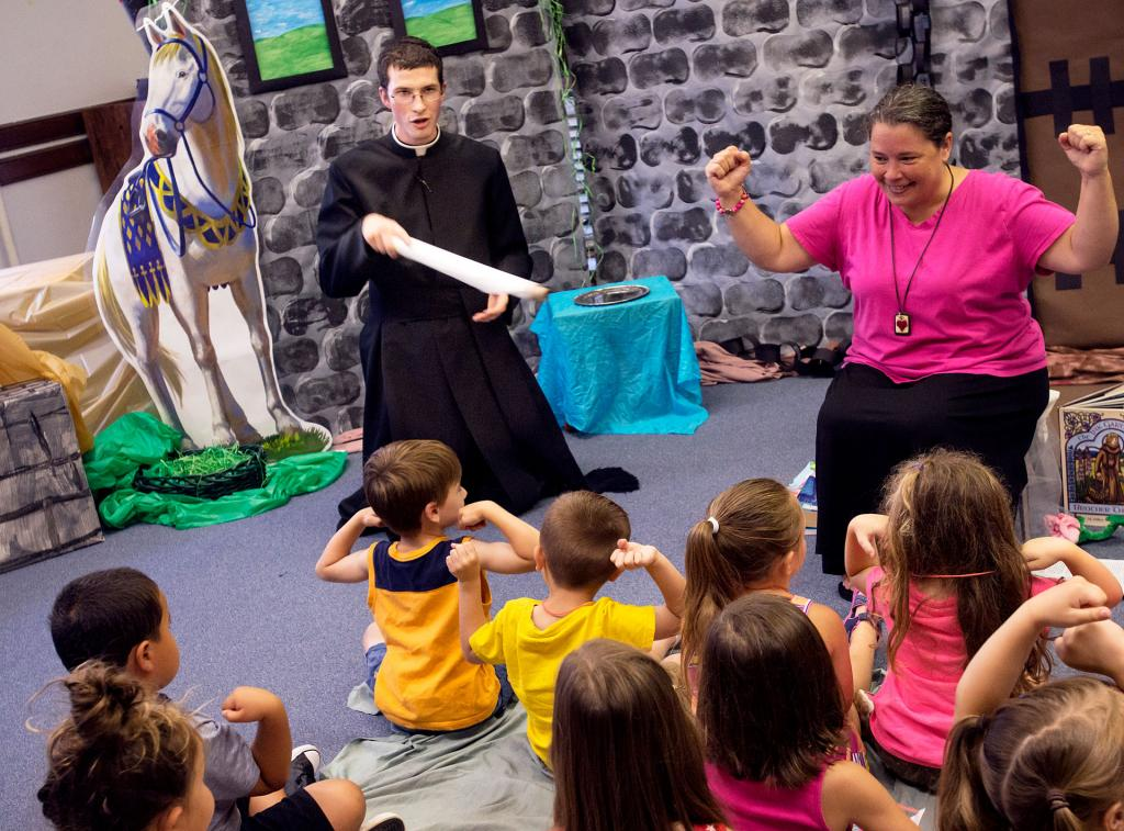 Seminarian Benjamin Knopf and instructor Nancy Joe Fisher-Bohrer lead a storytelling class during vacation Bible school at St. Francis and St. Clare Parish in Waterloo.