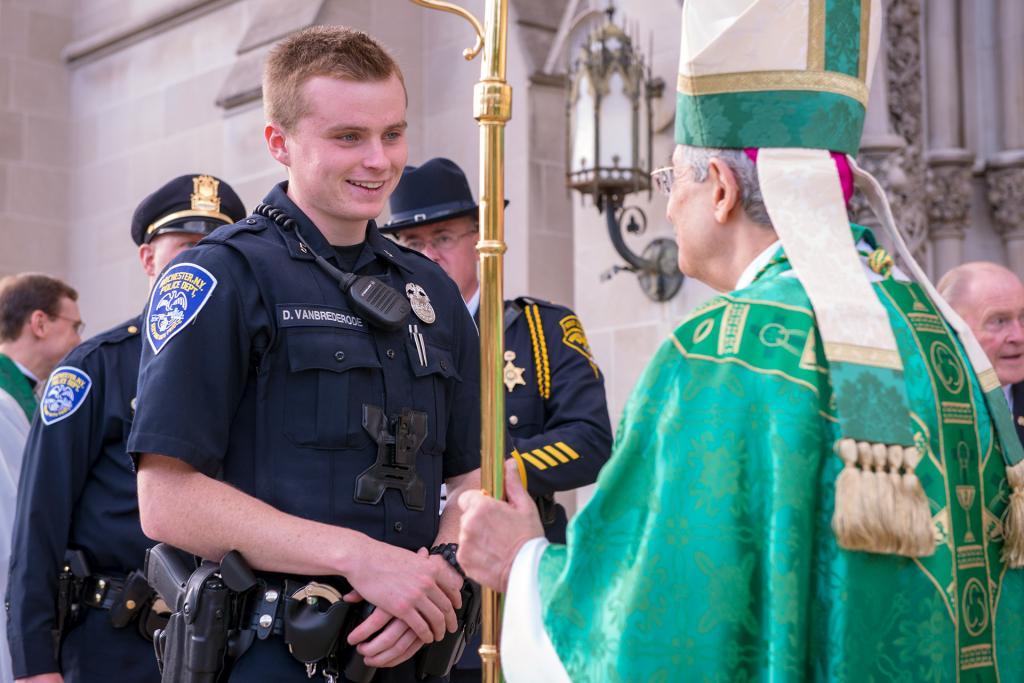 Rochester Police Officer Dakota Vanbrederode speaks to Bishop Salvatore R. Matano following the Blue Mass Sept. 29.