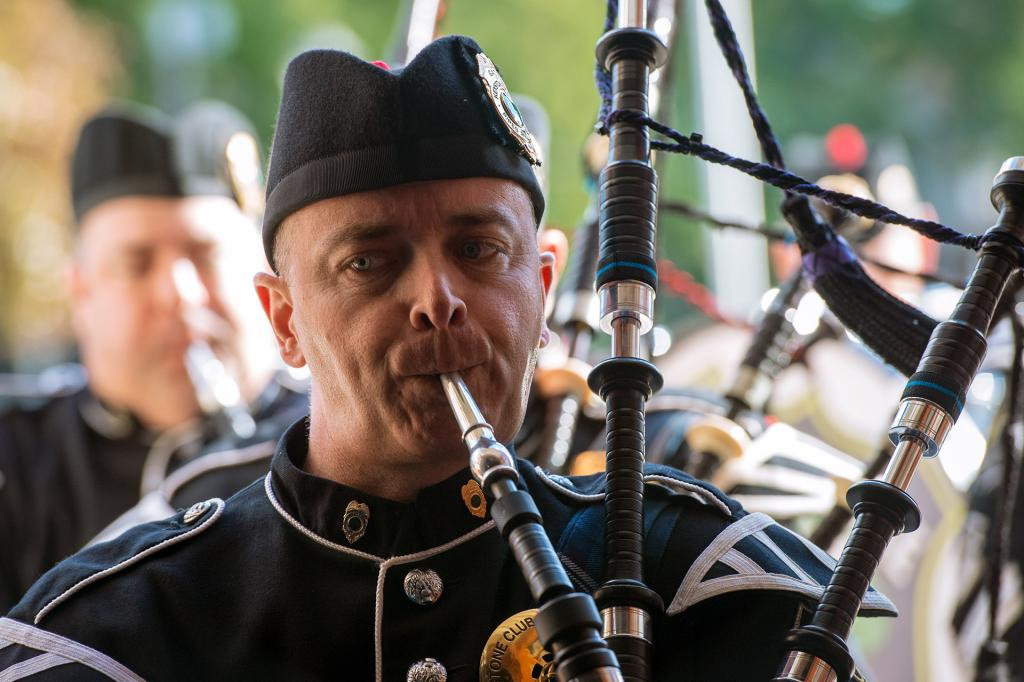 Keystone Pipes and Drums member Tom Frye plays the bagpipes during the procession into Sacred Heart Cathedral.
